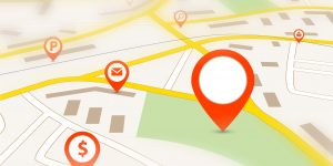 Navigation map with red empty pin pointer and tilt-shift effect